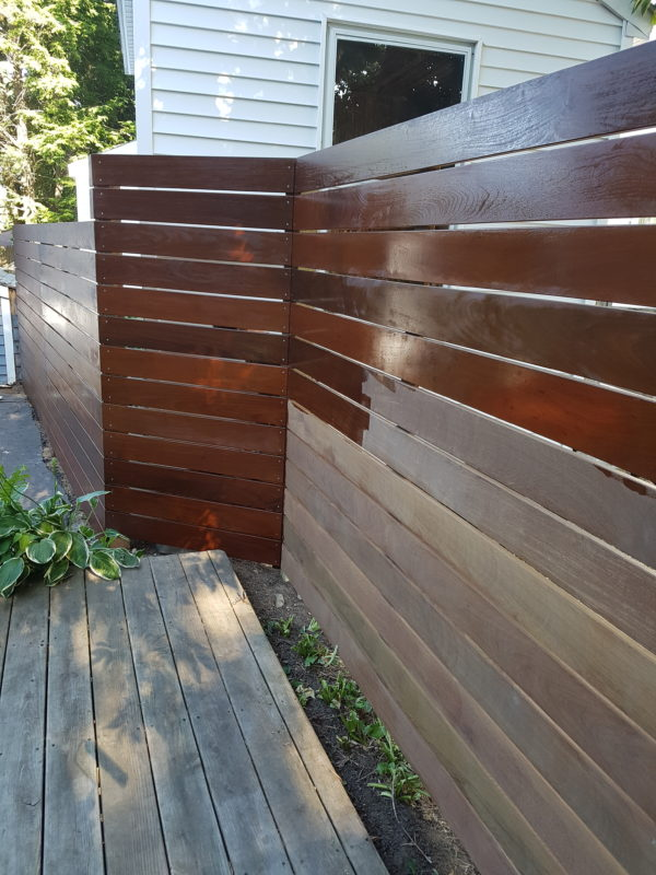 Ipe fence during application of penofin sealer